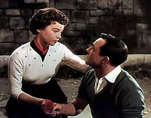 Gene Kelly - Leslie Caron and Kelly in the trailer for An American in Paris (1951)