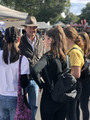 Andrew Wallace MP wearing an akubra hat and speaking to teenagers at the Maleny Agricultural Show.png