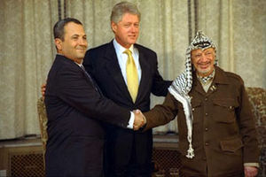 2000 Camp David Summit - Israeli prime minister Ehud Barak and Palestinian leader Yasser Arafat shake hands at the White House in Washington.