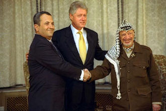 Ehud Barak - Ehud Barak shaking hands with Yasser Arafat, joined by President Bill Clinton (1999)