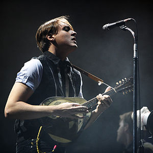 Win Butler - Butler performing with Arcade Fire in 2007 with resonator mandolin