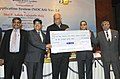 Ashok Gajapathi Raju Pusapati receiving a cheque of Rs. 279 crores as interim dividend for the year 2015-16 from the Chairman, Airports Authority of India, Shri R.K. Srivastava.jpg