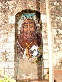 Murale raffigurante san Francesco, ad Assisi