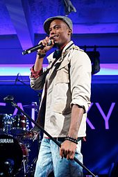 B.o.B performing with a michrophone.