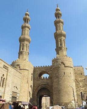 Bab Zuweila, a Fatimid gate with the Mamluk minarets of the Mosque of Sultan al-Mu'ayyad on top.