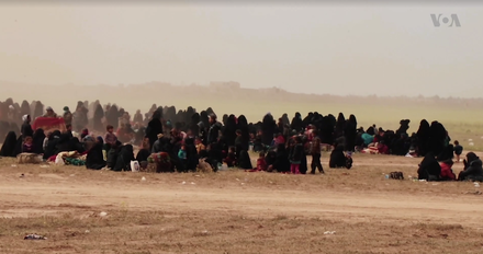 Civilians at an SDF-Coalition screening center, 8 March 2019. Most of the evacuees were families of Islamic State fighters Baghuz ISIL Families.png