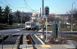 Baltimore Light Rail train entering Gilroy Road station, March 2000.jpg