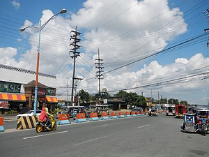 Batangas - Poles of the Batangas II Electric Cooperative in Lipa. Batangas II Electric Cooperative is one of three power distribution utilities operating in Batangas, along with Batangas I Electric Cooperative and Meralco.