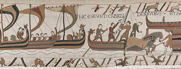Landing in England scene from the Bayeux Tapestry, depicting ships coming in and horses landing