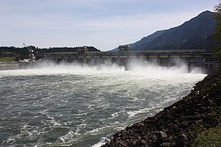 Bonneville Dam Run-of-the-river hydroelectricity dam structures, span Columbia River between Oregon and Washington state, at River Mile 146.1