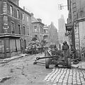 British Sherman tanks and a 6-pdr anti-tank gun in the centre of Caen, Normandy, 10 July 1944. B6924.jpg