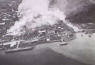 Bandar Seri Begawan - Brunei Town under Allied attack in 1945; the attack was intended to flush out the Japanese.