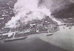 Brunei Town under Allied attack (AWM P00956.056)