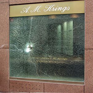 Bulletproof glass - Bulletproof glass of a jeweler's window after a burglary attempt
