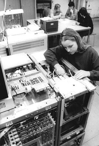 VEB Robotron - A worker at an assembly plant producing the ES 2655 mainframe.