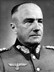 black and white head and shoulders portrait of male in German uniform with no cap