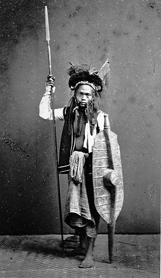 Military history of Indonesia - Nias warrior armed with spear and shield