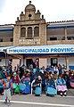 Calca Peru- elderly ladies gathered for ceremonies in honorary seats.jpg
