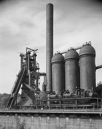 Hot blast - Blast furnace (left), and three Cowper stoves (right) used to preheat the air blown into the furnace