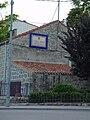 Casa con letrero en Collado Mediano.jpg