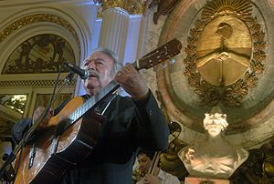 César Isella - César Isella singing at the White Hall of the Casa Rosada, 2008.