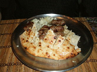 Bosnia and Herzegovina cuisine - Bosnian Ćevapi with onions in a somun