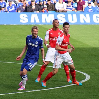 Laurent Koscielny - Koscielny and Kieran Gibbs playing for Arsenal in a match against Chelsea on 5 October 2014