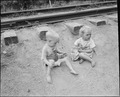 Children of miners playing by the railroad tracks which run a few yards from their front door. Raven Red Ash Coal... - NARA - 541105.tif