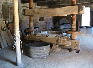 Saint Lawrence, Jersey - Cidermaking traditions are preserved at Hamptonne using a horse-drawn granite apple crusher and wooden two-screw press
