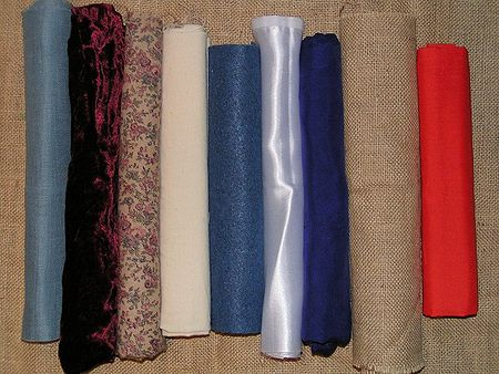 Variety of fabric. From the left: evenweave cotton, velvet, printed cotton, calico, felt, satin, silk, hessian, polycotton.