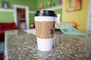 Coffee cup sleeve - Coffee cup sleeve on a coffee cup, sleeve makes it easy to hold hot drinks.