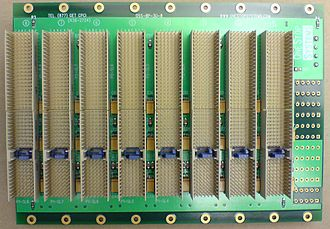 CompactPCI - A 3U CompactPCI backplane with J2 (top) and J1 (bottom, with blue key in the middle) connectors. The 32-bit PCI bus is carried on the J1 connector, while the J2 connector pins pass through to another connector on the back.