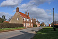 Cottages opposite the bus shelter Holme on the Wolds.jpg