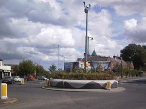 Ardoyne - Crumlin Road roundabout, with the Ardoyne shops on the left of the picture