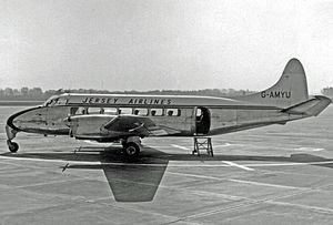 Jersey Airlines - Jersey Airlines Heron 1B at Manchester (Ringway) Airport in April 1955 on the schedule from Jersey