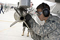 Defense.gov News Photo 110408-F-HG907-953 - Senior Airman Lucas Wolf loads a bomb onto an F-16 Fighting Falcon at Nellis Air Force Base Nev. during a quarterly weapons load competition on.jpg