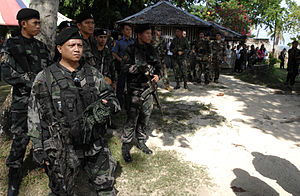 Special Action Force - SAF troopers on protection duty at a medical outreach program in 2010 in Lamitan, Philippines.