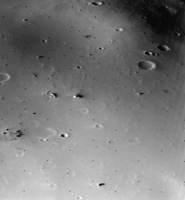 The surface of Deimos, a moon of Mars, is covered by a layer of regolith estimated to be 50 m (160 ft) thick. Viking 2 orbiter image is from a height of 30 km (19 mi).