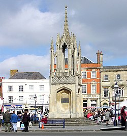 "The Market Cross, built in 1814. It displays the salutary tale of Ruth Pearce:""On Thursday, 25th January, 1753, Ruth Pearce of Potterne in this county, agreed with three other women to buy a sack of wheat in the Market, each paying her due proportion towards the same. One of these women, in collecting the several quotas of money, discovered a deficiency, and demanded of Ruth Pearce the sum which was wanting to make good the amount. Ruth Pearce protested that she had paid her share, and said: ' She wished she might drop down dead if she had not.' She rashly repeated this awful wish, when to the consternation and terror of the surrounding multitude, she instantly fell down and expired, having the money conƒealed in her hand."""