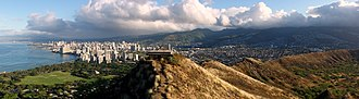 Diamond Head, Hawaii - View from the rim showing the Waikīkī neighborhood (left), the cone (right) and the pillbox at the peak (middle)