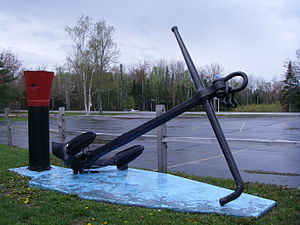 SS M.M. Drake (1882) - Anchor and windlass from M.M. Drake (1882) displayed next to Whitefish Township Community Building