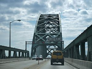 Burlington County, New Jersey - View from the roadway of the Tacony-Palmyra Bridge, across the upper Delaware River from Palmyra, New Jersey to Tacony section of Philadelphia with drawbridge signs