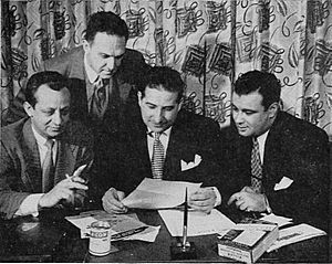 D-CON - 1950 d-CON meeting. From left to right: Jermone Garland, d-CON vice president of sales; Joe Adams, d-CON public relations director; Lee Ratner, d-CON president; Alvin Eicoff, Marfree vice president