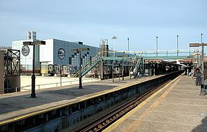 East 180th Street (IRT White Plains Road Line) - Northbound view of the station platforms, with the East 180th Street Yard off to the left.