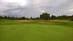 Edzell Golf Club 17th hole green and disused Edzell railway line.jpg