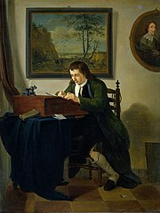 A Man Writing at his Desk