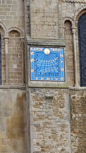 Vertical sundial on South Transept Wall Ely Cathedral hours.jpg