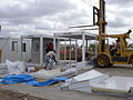 FEMA - 39314 - Workmen begin constructing living units in Kansas.jpg