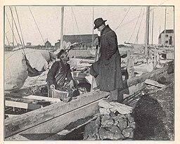 FMIB 43775 Landing the catch on the wharf