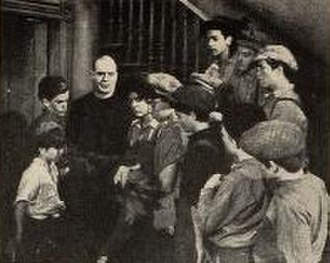 Fighting Father Dunne - O'Brien surrounded by his street urchins